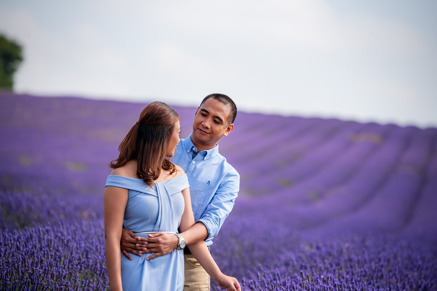 Happily married and in love couple looking at each other in lavender field